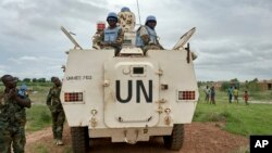 FILE - Peacekeepers from the United Nations Mission in South Sudan (UNMISS) provide security in Bentiu, South Sudan, June 18, 2017.