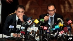 Egyptian investigative judges Sameh Abu Zeid, right, and Ashraf el-Ashmawi, who are investigating the case of foreign funding of NGOs, talk during a press conference at the Ministry of Justice in Cairo, Feb. 8, 2012.