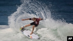 FILE - Hawaiian surfer Mick Fanning competes in the 2015 Oi Rio Pro World Surf League competition at Barra da Tijuca beach in Rio de Janeiro, Brazil, May 12, 2015.