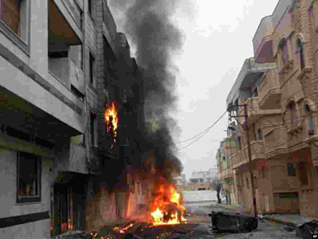This citizen journalism image provided by the Local Coordination Committees in Syria shows a Homs neighborhood hit by government shelling on February 15, 2012. (AP)