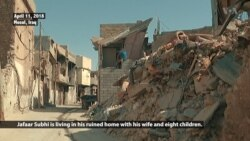Family Returns to Crumbling Home in Old Mosul
