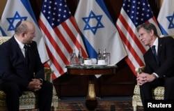 U.S. Secretary of State Antony Blinken meets with Israeli Prime Minister Naftali Bennett at the Willard Hotel in Washington, Aug. 25, 2021.