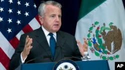 "Deputy Secretary of State John J. Sullivan told a press conference in Washington, Dec. 14, 2017, the Trump administration ""refuses to ignore the problem"" of transnational crime."