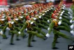 "Military personnel take part in a parade celebrating the 40th anniversary of the end of the Vietnam War which is also remembered as the ""Fall of Saigon,"" in Ho Chi Minh City, Vietnam, April 30, 2015."