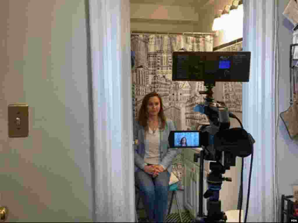 Broadcasting live to affiliates in Latin America, Celia Mendoza, a VOA Spanish service broadcaster, produces live remotes from her bathroom, turning the space into a television studio with a Washington, D.C.-themed shower curtain as a backdrop