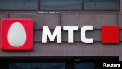 A logo of MTS mobile phone operator is seen on a building in central Moscow, Russia, March 10, 2016.