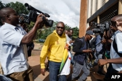 Zimbabwe cleric and activist Pastor Evan Mawarire arrives at the Harare Magistrates Court on January 17, 2019, to appear in court, accused of inciting violence through social media, after he was arrested by armed police at his home in Harare