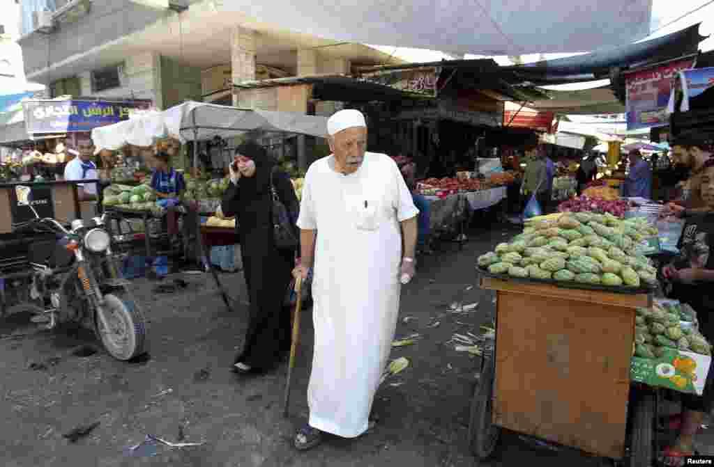 A Palestinian man walks through a market in Gaza City, July 17, 2014.