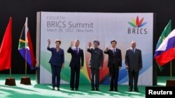A Mar. 29, 2012 photo shows (L-R) Brazil's President Dilma Rousseff, Russian Pres. Dmitry Medvedev, Indian PM Manmohan Singh, former Chinese Pres. Hu Jintao and South African Pres. Jacob Zuma at the BRICS Summit in New Delhi, India.