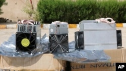 "This undated photo provided by the Police News Agency, shows boxes of machinery used in Bitcoin ""mining"" operations that were confiscated by police in Nazarabad, Iran. (News.police.ir via AP)"