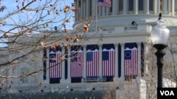 Flags are hung on the U.S. Capitol building in Washington, D.C., in preparation for Friday's inauguration of Donald Trump.
