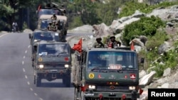 An Indian Army convoy moves along a highway leading to Ladakh, at Gagangeer in Kashmir's Ganderbal district, June 18, 2020.