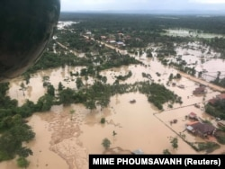 file - Aerial view shows the flooded area after a dam collapsed in Attapeu province, Laos, July 25, 2018, in this image from social media.