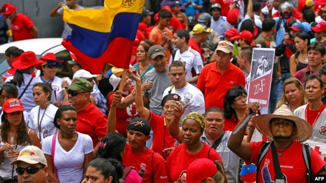 Supporters of Venezuelan President Hugo Chavez take part in a rally in Caracas to commemorate 24 years of the Patriotic Rebellion of 1989, Feb. 27, 2013,