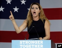 Former Miss Universe Alicia Machado gestures before a speech by Democratic presidential candidate Hillary Clinton, Nov. 1, 2016