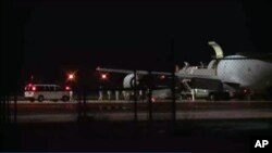 In this image from video people are greeted on arrival at Lackland Air Force Base in San Antonio Texas early Friday morning June 13, 2014.
