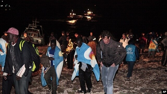 Migrants fleeing Libya unrest arrive on the island of Lampedusa, Italy on May 8, 2011.