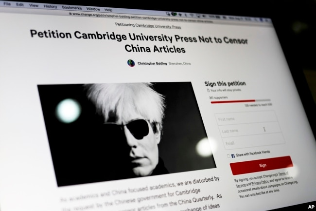 FILE - A computer screen shows an online petition page urging Cambridge University Press to restore more than 300 politically sensitive articles removed from its website in China after a request from authorities, in Beijing, Aug. 21, 2017.