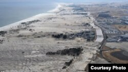 Giant tsunami waves hit coast of Japan.