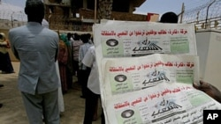 A Sudanese man holds three archive copies of 'Rai al-Shaab' newspaper which was confiscated, 16 May 2010.