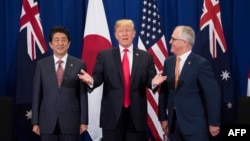 Japan's Prime Minister Shinzo Abe, left, U.S. President Donald Trump and Australia Prime Minister Malcolm Turnbull attend a trilateral meeting during the opening ceremony of the 31st Association of South East Asian Nations (ASEAN) Summit in Manila on Nove