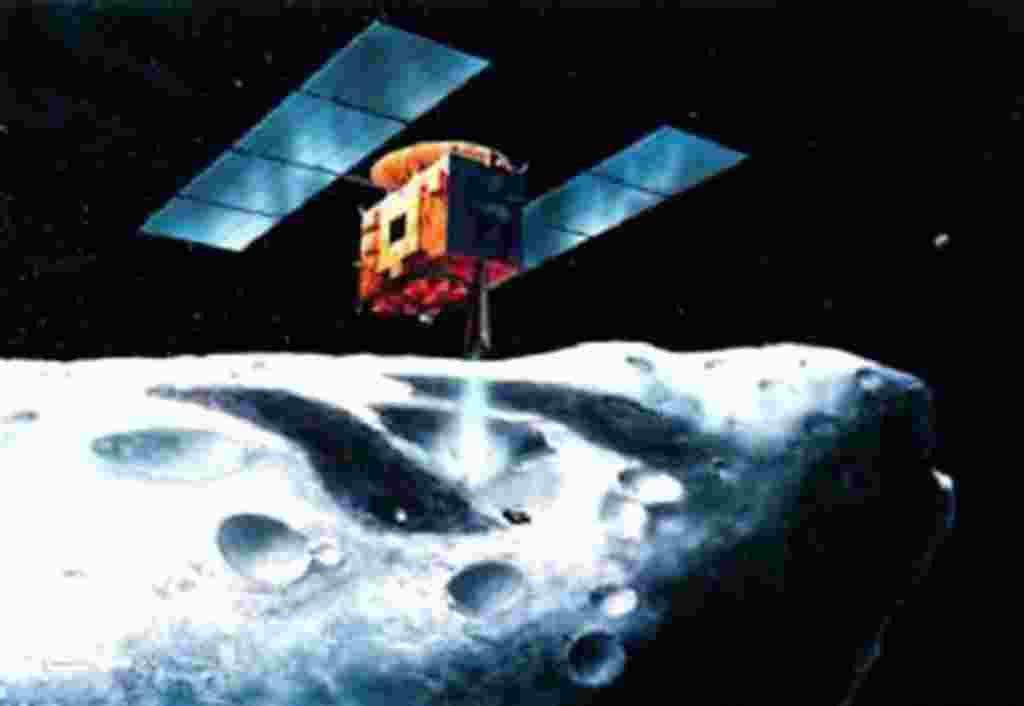 En esta versión artística distribuida por la Agencia Espacial Japonesa de Exploración se puede ver a la sonda Hayabusa flotando encima de un asteroide a unos 290 millones de kilómetros de distancia entre la Tierra y Marte.