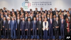 Leaders and delegates pose for a group picture during the Brussels Conference on Afghanistan, in Brussels, Belgium Oct. 5, 2016.