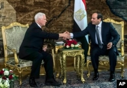 FILE - U.S. Vice President Mike Pence shakes hands with Egyptian President Abdel-Fattah el-Sissi at the Presidential Palace in Cairo, Jan. 20, 2018.