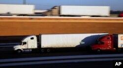 FILE - Trucks move along Interstate 35, in Laredo, Texas, Nov. 21, 2016.