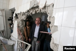 FILE - Resident Coordinator of the United Nations in Yemen, Jamie McGoldrick, inspects damage at a hospital in Yemen's southwestern city of Taiz, Jan. 21, 2016.