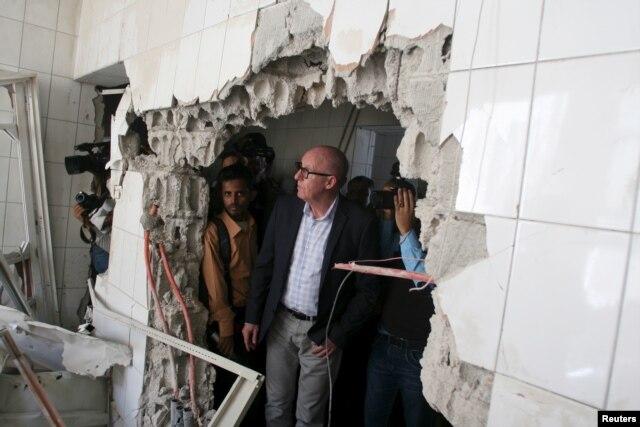 FILE - Resident Coordinator of the United Nations in Yemen, Jamie McGoldrick, inspects damage at a hospital in Yemen's southwestern city of Taiz, Jan. 21, 2016.