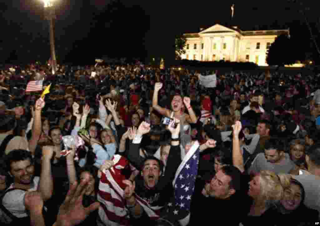 Crowds gathers outside the White House in Washington early Monday, May 2, 2011, to celebrate after President Barack Obama announced the death of Osama bin Laden. (AP Photo/Manuel Balce Ceneta)