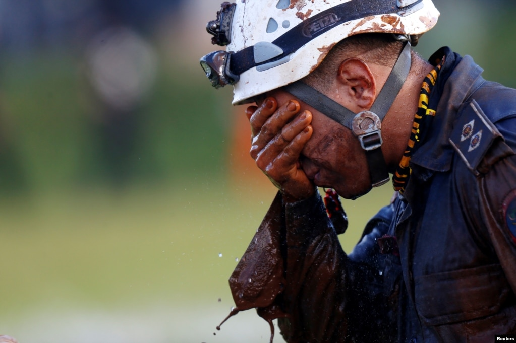A member of a rescue team reacts after searching for survivors of the collapse of a dam owned by Brazilian mining company Vale SA, in Brumadinho, Jan. 27, 2019.
