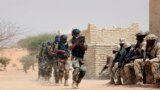 FILE - In this March 7, 2015 file photo, Nigerian special forces and Chadian troops participate with US advisors in the Flintlock exercise in Mao, Chad.