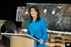 FILE - U.S. Ambassador to the U.N. Nikki Haley speaks in front of recovered segments of an Iranian rocket during a press briefing at Joint Base Anacostia-Bolling, Dec. 14, 2017, in Washington.