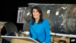 U.S. Ambassador to the U.N. Nikki Haley speaks in front of recovered segments of an Iranian rocket at Joint Base Anacostia-Bolling, Dec. 14, 2017.