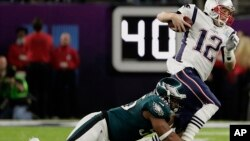 Philadelphia Eagles defensive end Brandon Graham (55) tackles New England Patriots quarterback Tom Brady (12), during the first half of the NFL Super Bowl 52 football game, Sunday, Feb. 4, 2018, in Minneapolis.