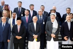 FILE - Afghan President Ashraf Ghani poses for a group photo during a peace and security cooperation conference in Kabul, Afghanistan, Feb. 28, 2018.