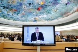 FILE - Russian Foreign Minister Sergey Lavrov is seen on a monitor, speaking at a session of the U.N. Human Rights Council at the United Nations in Geneva, Switzerland, Feb. 28, 2018. Lavrov has been accusing the U.S. of unilateralism.