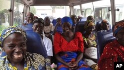 FILE - Family members of the Nigerian Chibok kidnapped girls share a moment as they depart to the Nigerian minister of women affairs in Abuja, Nigeria, Oct. 18, 2016. Nigeria's government is negotiating the release of another 83 of the Chibok schoolgirls taken in a mass abduction in 2014.