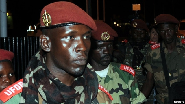 Soldiers from Central African Republic's Seleka rebel group arrive at the airport ahead of planned peace talks with the Central African Republic's government, Libreville, Gabon, Jan. 7, 2013.