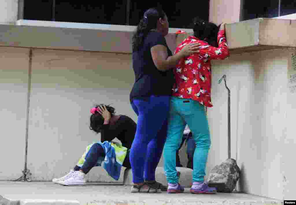 Relatives of one of the inmates killed during a fight between armed gangs at El Porvenir prison, react outside the morgue, in Tegucigalpa, Honduras, Dec. 23, 2019.