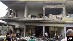 Hama'da bir patlamanın ardından meydana gelen bir enkaz (SANA)