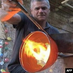 Baltimore glass blower Anthony Corradetti shapes a decorative bowl he will later sell in his studio gift shop