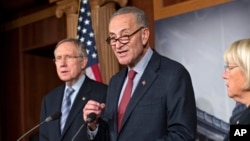 From left, Senate Majority Leader Harry Reid, D-Nev., Sen. Chuck Schumer, D-N.Y., the Democratic Policy Committee chairman, and Sen. Patty Murray, D-Wash., the Budget Committee chair, repeat their resolve to not touch the Affordable Care Act, on Capitol Hill in Washington, Sept. 19, 2013.