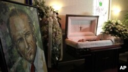 The body of the former Venezuelan president Carlos Andres Perez lies in a casket at a funeral home in Miami, Tuesday, Dec. 28, 2010