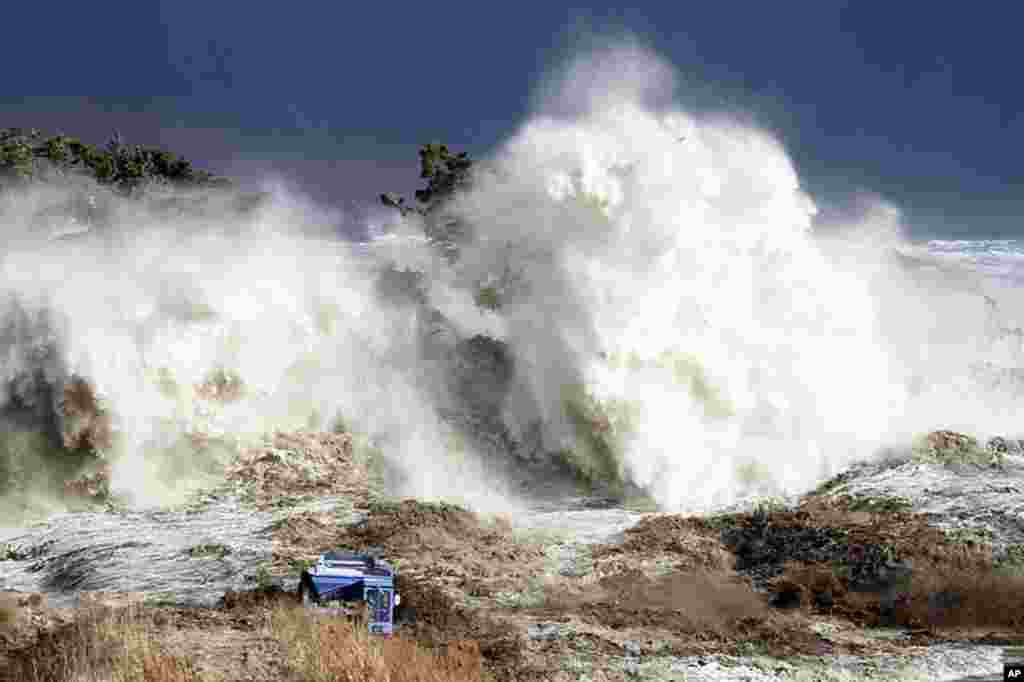 This picture taken on March 11, 2011 shows tsunami waves hitting the coast of Minamisoma in Fukushima prefecture. The number of people confirmed dead or listed as missing in Japan neared 22,000, 10 days after a massive earthquake and tsunami struck the co