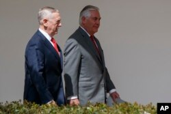 FILE - Defense Secretary Jim Mattis, left, walks with Secretary of State Rex Tillerson at the White House in Washington, April 3, 2017. Mattis and Tillerson will be among officials briefing U.S. senators on North Korea.