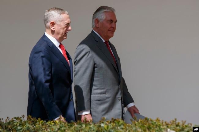 FILE - Defense Secretary Jim Mattis, left, walks with Secretary of State Rex Tillerson at the White House in Washington, April 3, 2017. Mattis and Tillerson will be among officials briefing U.S. senators on North Korea.