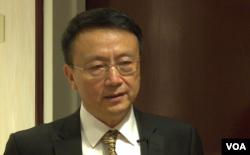 北大教授贾庆国在华盛顿一个智库的研讨会上(2014年4月19日,美国之音黎堡拍摄)